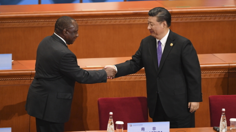 South Africa's President Cyril Ramaphosa (L) shakes hands with China's President Xi Jinping